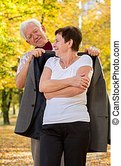 Elderly man caring about his wife - Image of elderly man...