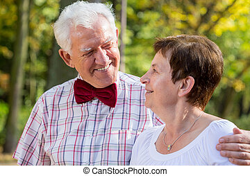 Elderly man wearing bowtie and his wife