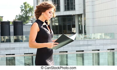 A business woman reading a contract