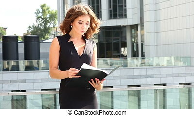Beautiful business woman reading a commercial contract....