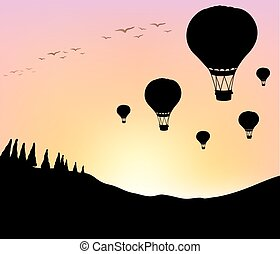 Silhouette balloons in the sky