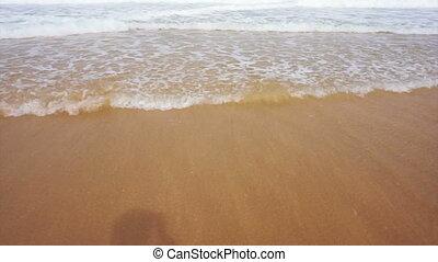 Sea waves washing feet at beach - Sea waves washing womans...