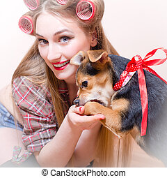 Cropped picture of smiling young beautiful girl playing with...