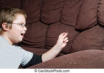Finding Money - A person Finding Money in couch cushions.
