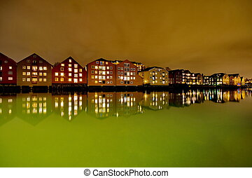 Houses on the water at night in Trondheim, Norway