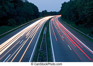 Tail lights - Cars speeding on a motorway