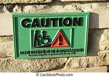 caution sign to help disabled people