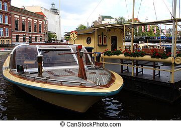 Amsterdam canal and boat for visiting city