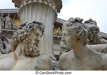 vienna, austrian parliament and sculpture of mythological...