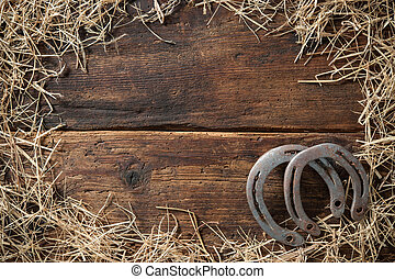 Two old rusty horseshoes with straw - Two old rusty...