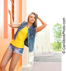 Fashion pretty woman wearing a jeans clothes outdoors in the...