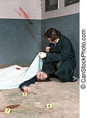 Examining a corpse - Police inspector examining a dead body,...