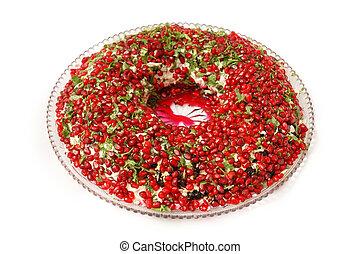 Big bowl of salad garnished with pomegranate seeds