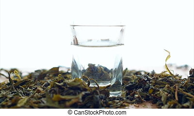 Tea leaf dissolving in hot water