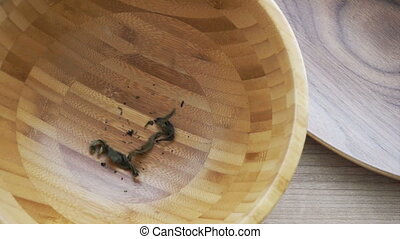 Dried Tea leaf pouring wooden bowl - Dried Tea leaf pouring...