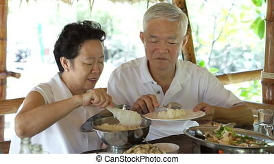 Asian senior talking care couple