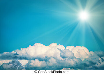 White clouds and bright sun on the blue sky. Nature...