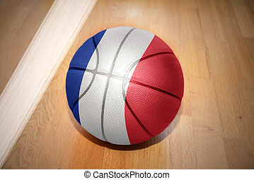 basketball ball with the national flag of france lying on...