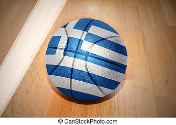 basketball ball with the national flag of greece lying on...