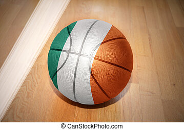 basketball ball with the national flag of ireland lying on...