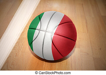 basketball ball with the national flag of italy lying on the...