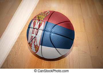 basketball ball with the national flag of serbia lying on...
