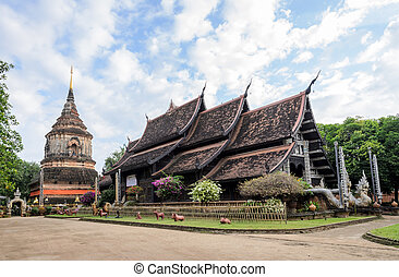Ancient Thai wooden temple - Thai Lanna wooden monastery and...