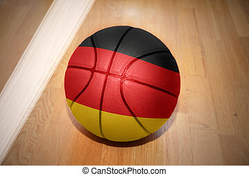 basketball ball with the national flag of germany lying on...