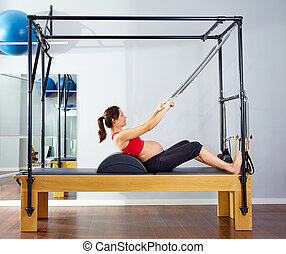 pregnant woman pilates reformer roll up exercise - pregnant...
