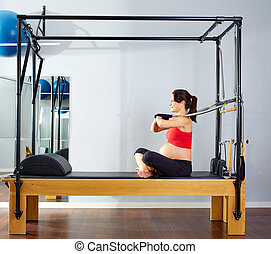pregnant woman pilates reformer arms exercise - pregnant...
