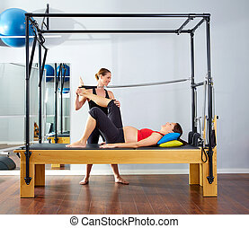 pregnant woman pilates reformer leg spring exercise workout...