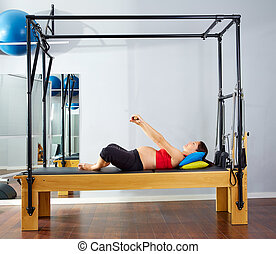 pregnant woman pilates reformer cadillac exercise workout at...