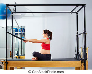 pregnant woman pilates reformer forward push through...