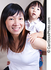 Happy family. - Happy young mother playing with her...