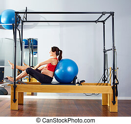 pregnant woman pilates reformer fitball exercise workout at...