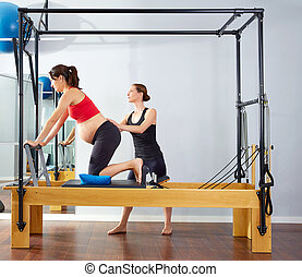pregnant woman pilates reformer cadillac exercise workout...