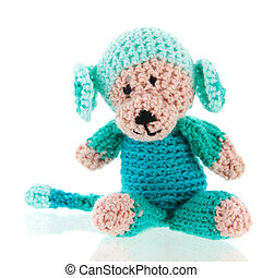 knitted stuffed animal - Knitted stuffed monkey isolated...