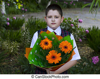 the school student with a beautiful bouquet of flowers, the front view