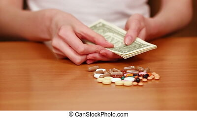 Woman Counts Money For Drugs