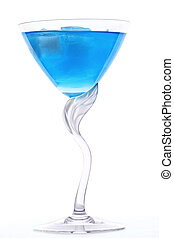 Blue cocktail - Glass of blue cocktail with ice against...