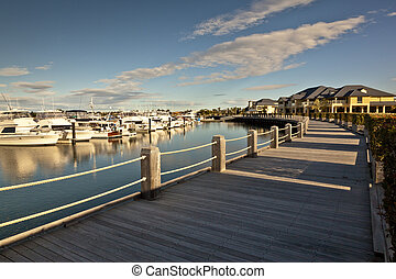 Beautiful wooden pathway in front of a marina