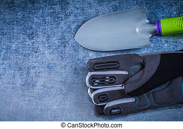 Composition of metal trowel protective gloves on scratched metal
