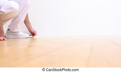 painter man at work, removes tape - painter man at work,...
