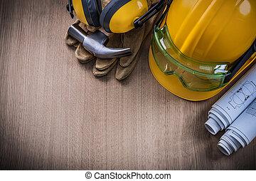 Hammer safety glasses blueprints protective gloves hard hat...