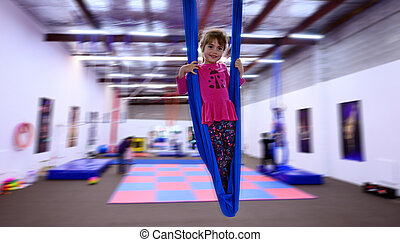 Little child learn circus skills on Aerial Strap - Little...