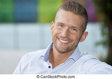 Portrait Of Mature Man Smiling - Portrait, Close-up, Wall -...