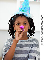 Portrait of a little boy at a birthday party