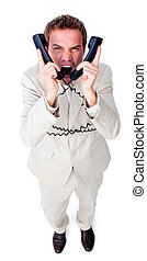 Angry businessman yelling and tangled up in phone wires