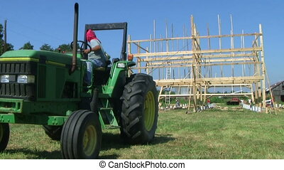 Barn Building Frame - Workers building barn frame.