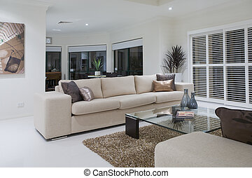 Luxurious living room with dining table in the background